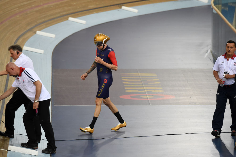 Bradley Wiggins walks to his bike with the sellout crowd cheering him on