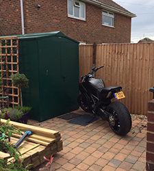 A bricked patio gives easy access into the Asgard Centurion Motorbike Storage