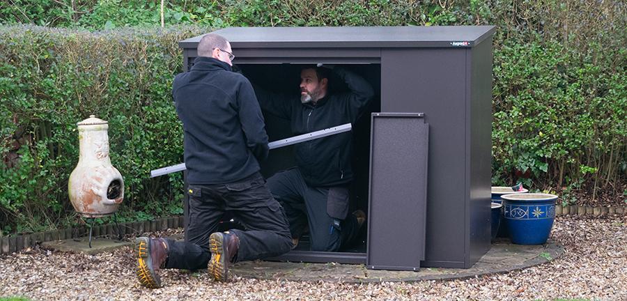 Asgard bike shed installation team