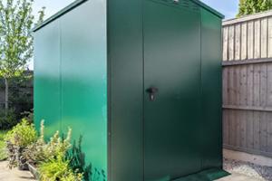Metal lawnmower storage with ventilation system