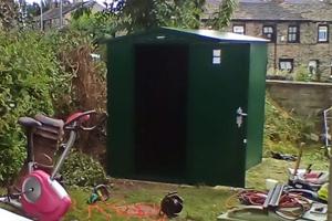 Green 5x7 lawnmower storage shed