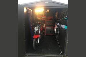 Asgard motorbike storage shed with rubber matt floor
