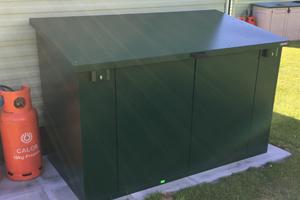 Green caravan storage box with lift up lid