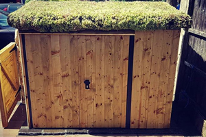Customer's Asgard metal shed with bespoke wooden cladding