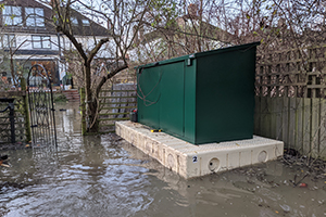 Access garden shed floating in flood