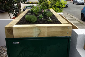 Asgard metal bike safe with green roof planter