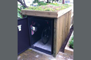 Customer bike safe with bespoke cladding and garden roof