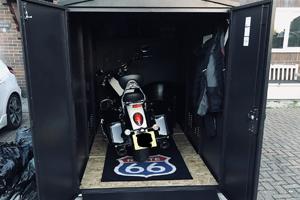 Secure motorcycle storage with motorbike matt