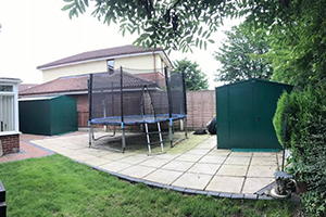 Two Gladiator Sheds in Garden