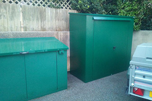 Two asgard sheds in the garden