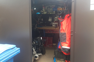 Motorcycle storage with a workbench to create a tool shed and work shop