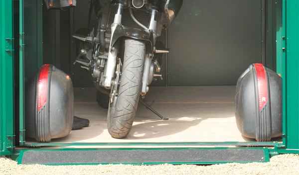 Large motorcycle garage with metal floor