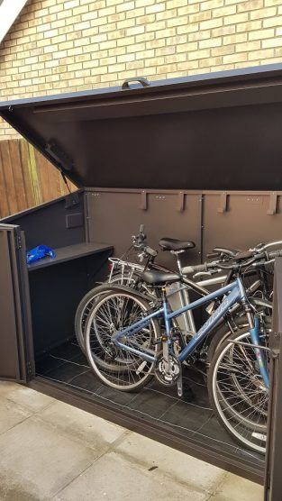 Access bike storage shed with lift up lid