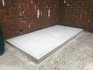 A level concrete base for the Annexe Bike Storage